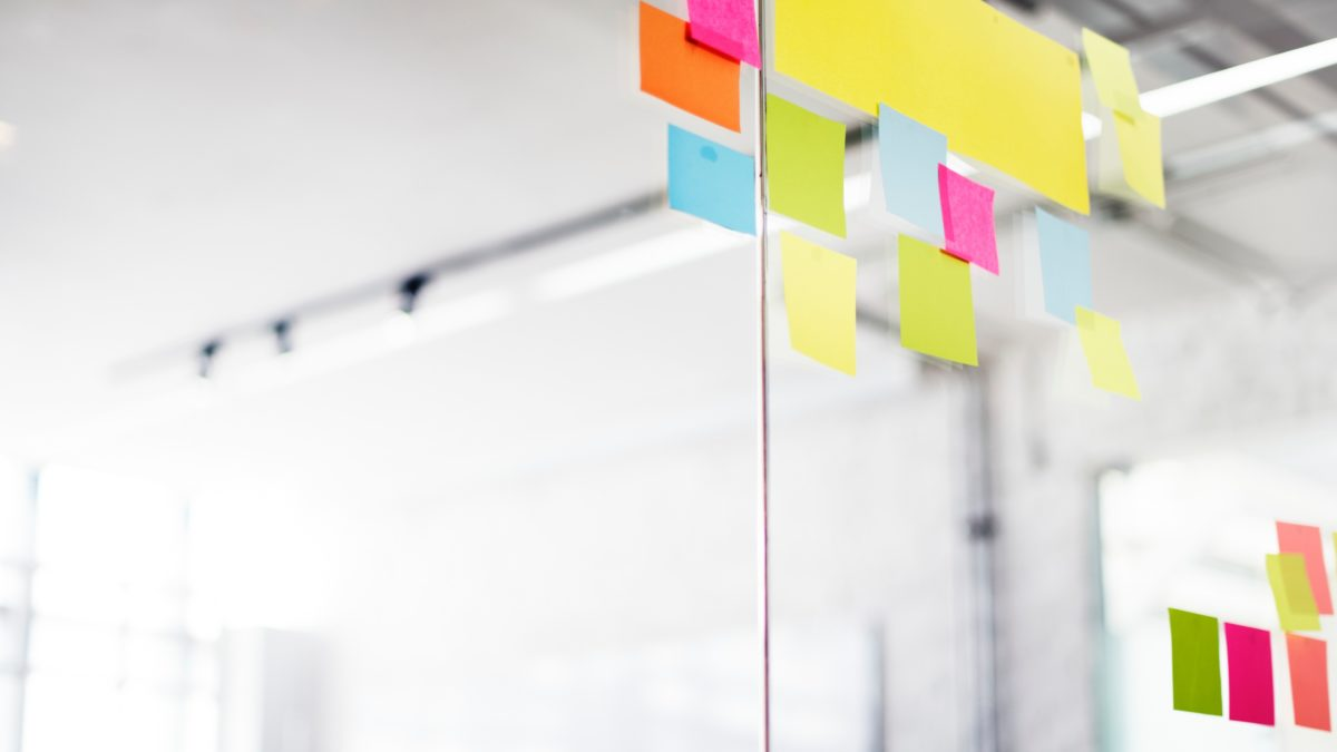 Colourful sticky notes on clear wall